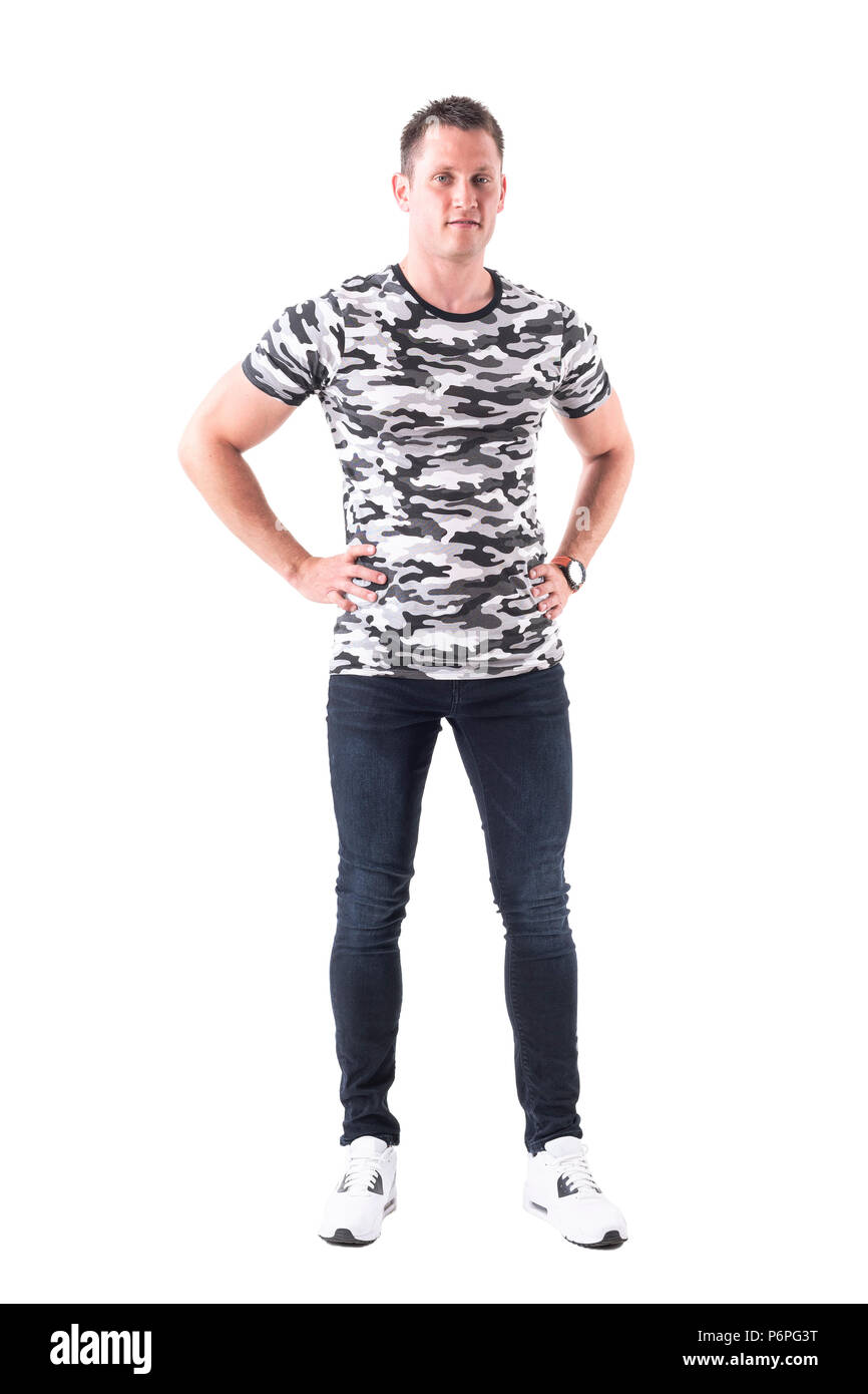 Relaxed happy caucasian adult man standing with hands on hips and smiling at camera. Full body isolated on white background. - Stock Image