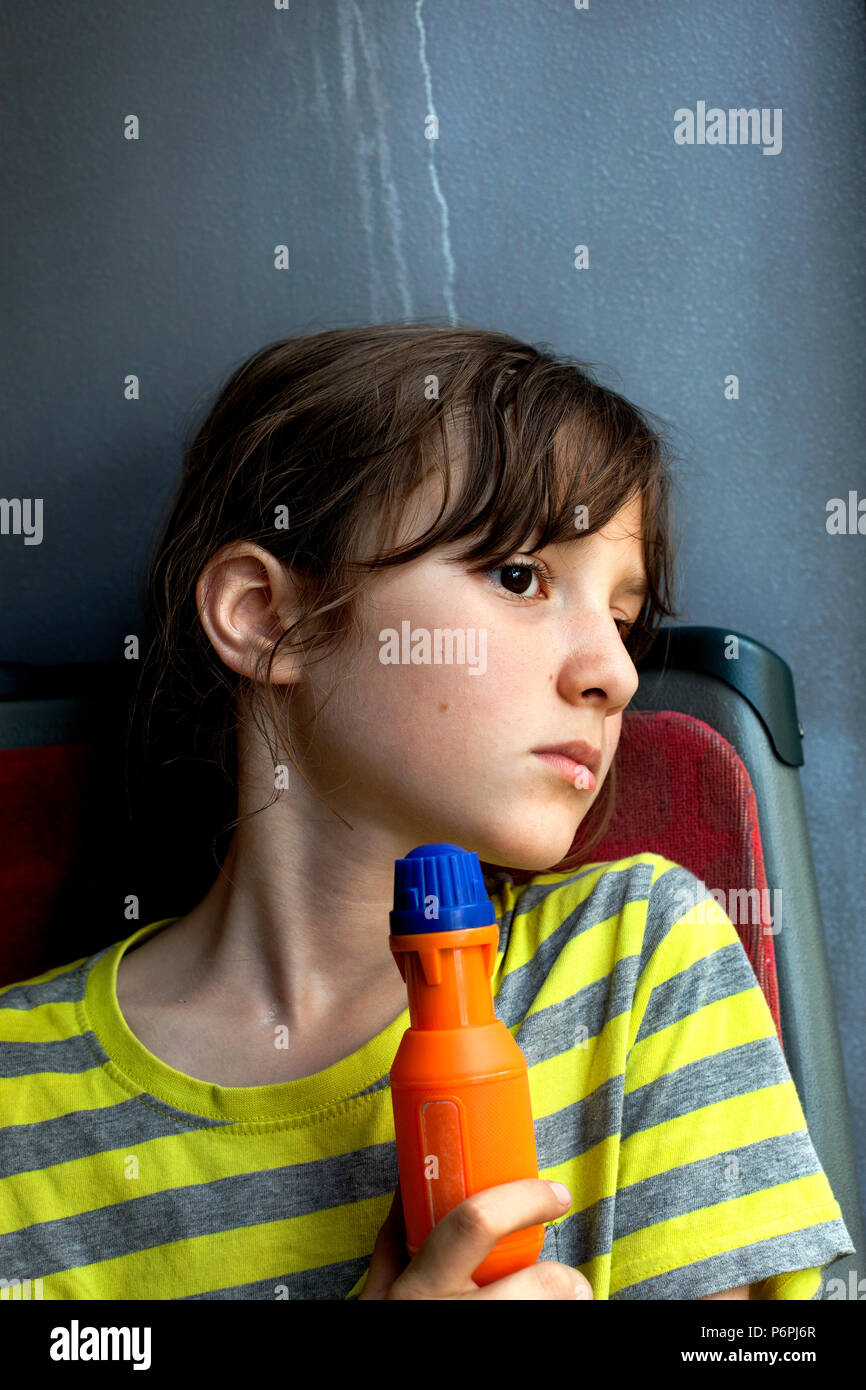 Boy looking disappointed on bus. - Stock Image