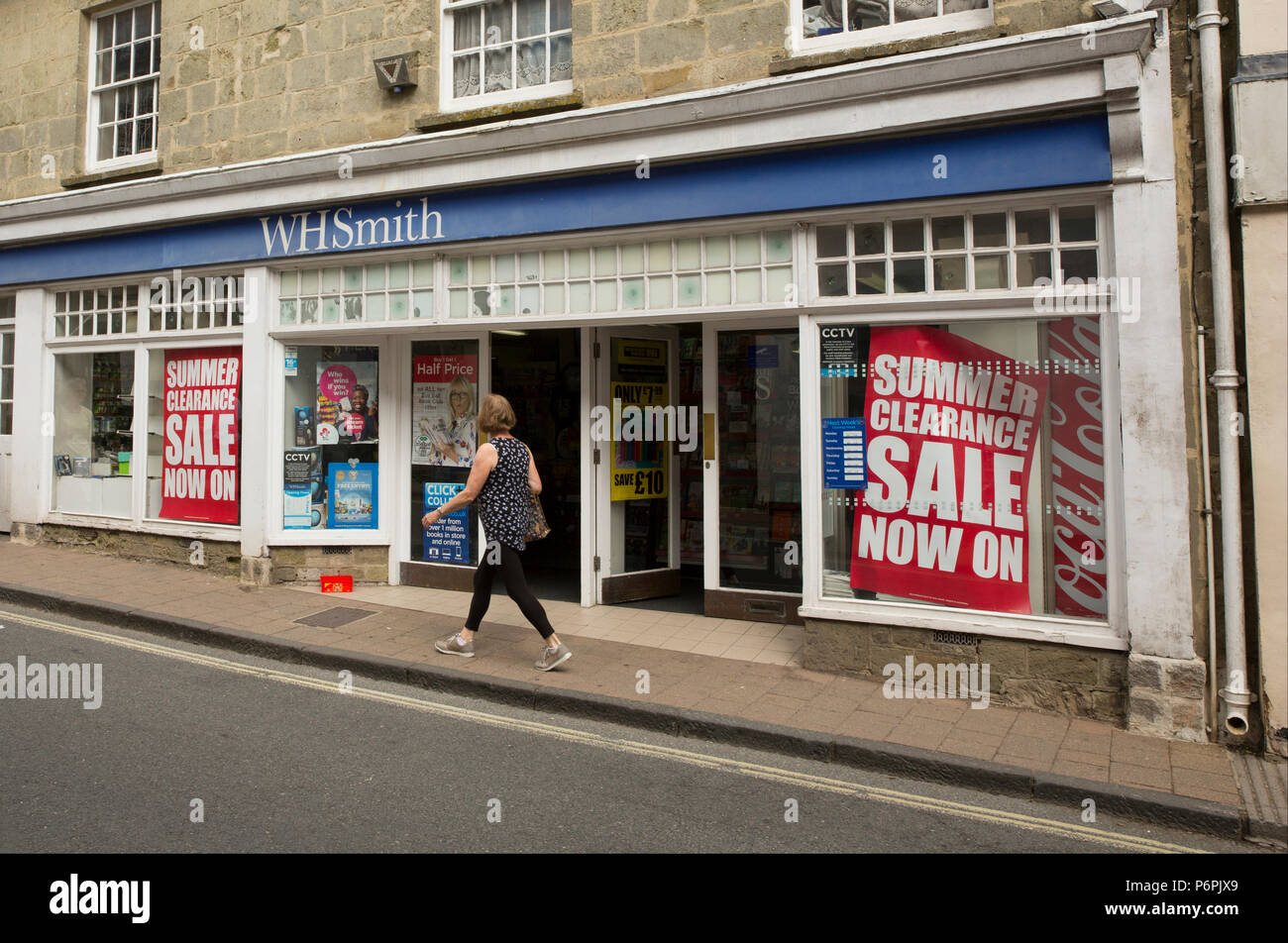 A WH Smith store in Shaftesbury Dorset advertising a summer clearance sale. North Dorset England Uk Gb - Stock Image