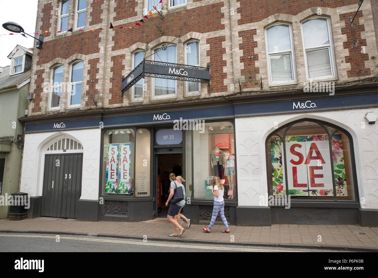 An M&Co store advertising a sale on the main street of Shaftesbury in North Dorset England UK GB. - Stock Image