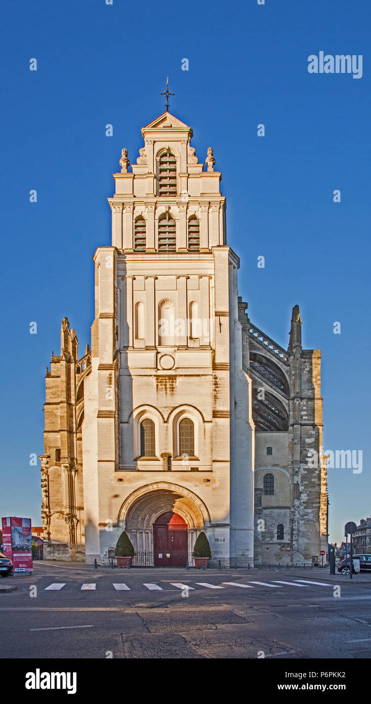 Front facade of Cathedral basilica basilique catholic Cathedral on Rue Adrien Nordet St Quentin Aisne France in sunlight with blue sky beyond Stock Photo