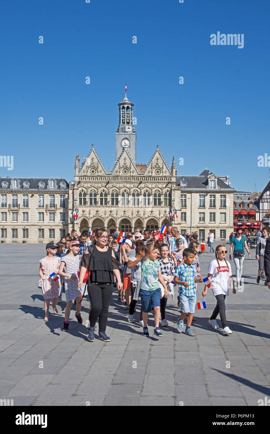 School teacher and pupils stundents marching on Victory In Europe VE day 8th May 2018 in Place de l'Hotel de Ville St Quentin, Aisne, France. Stock Photo