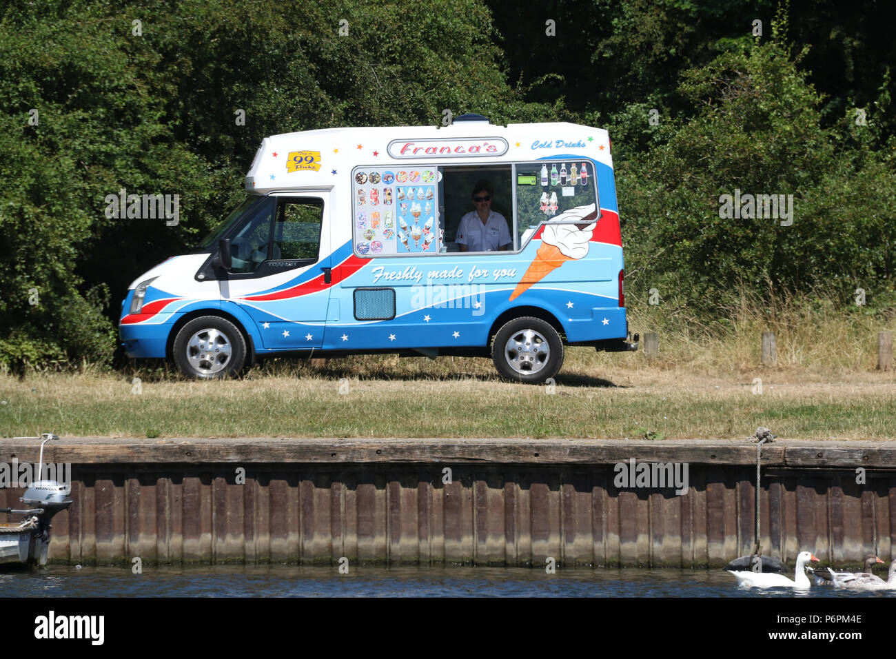 ddb596e7f9 An ice cream van parked next to the River Thames at Bourne End. - Stock