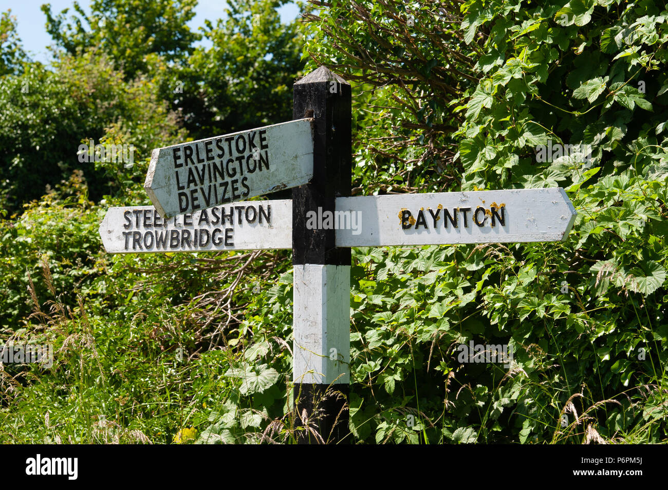 Traditional roadside, black and white signpost in Wiltshire, UK - Stock Image