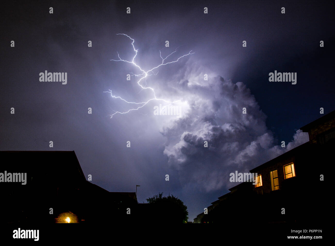 Cloud to Cloud lightning strikes over the urban rooftops in the night skies, Johannesburg Stock Photo