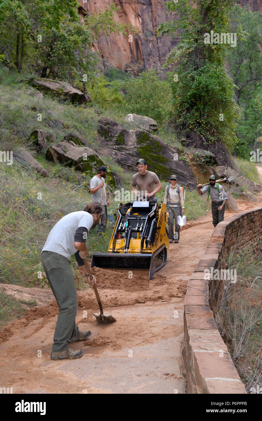 Maintenance workers repairing damages on a trail caused by abundant rain. Zion National Park, Utah, USA. - Stock Image