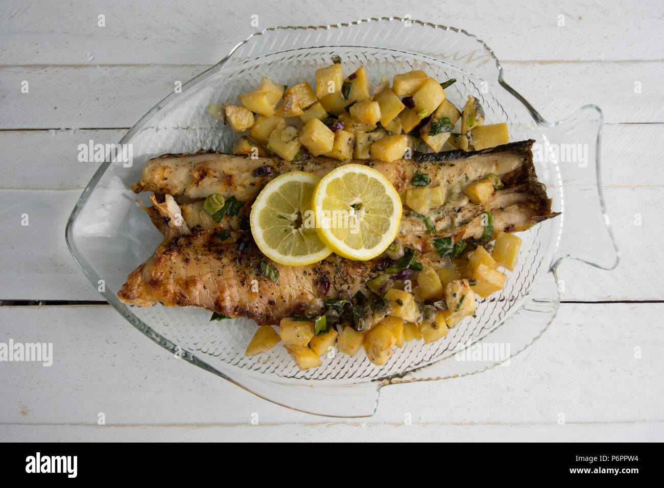 Fish and chips with fresh herbs - Stock Image