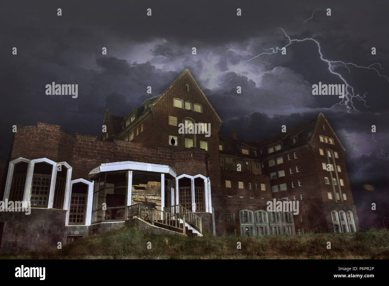 Ruins of what used to be a great hotel casino in Punta del Este, Uruguay. It is abandoned nowadays and looks creepy in stormy nights. - Stock Image