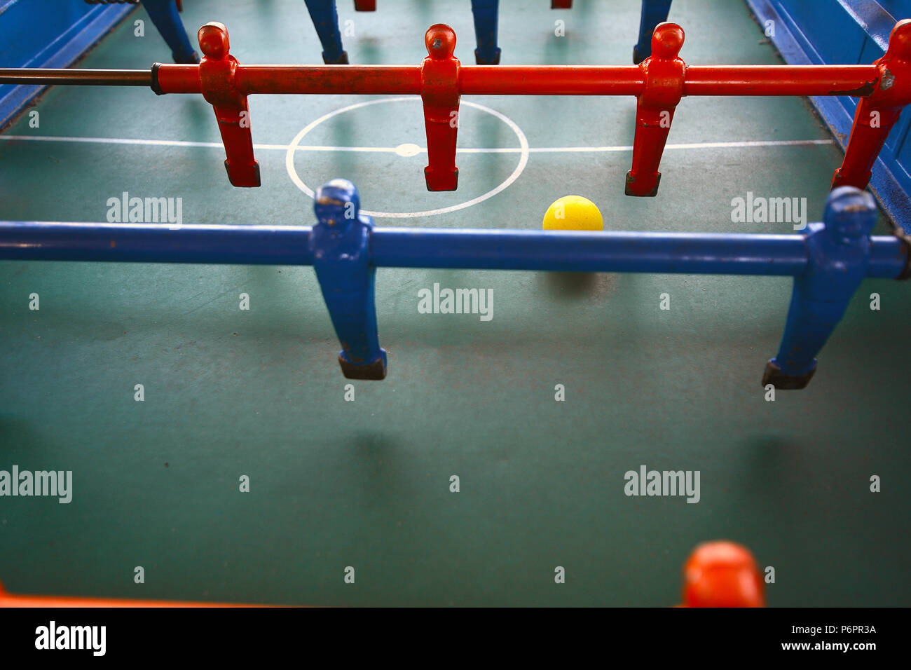 Foosball. Soccer table game, blue foosball player. Toy sport game concept. - Stock Image
