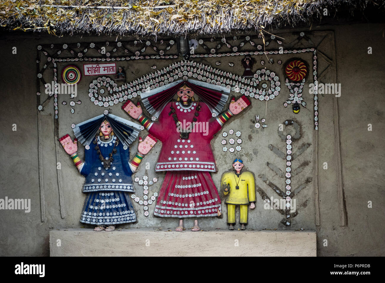 Exhibit of a wall painting with colorful figures in the National Crafts Museum, New Delhi, India - Stock Image