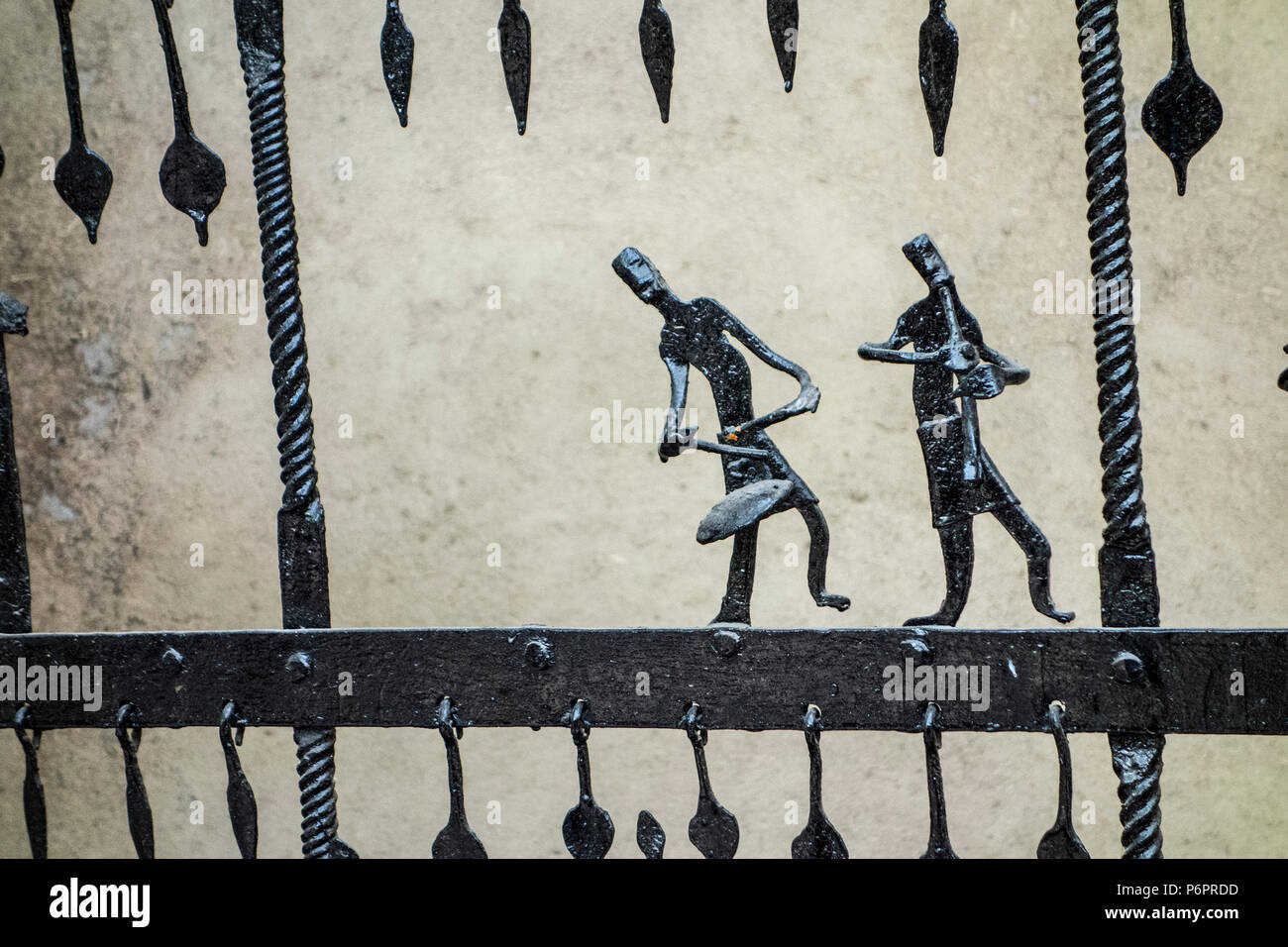Exhibit of a wrought iron gate or fence from Bastar, Chhattisgarh with musician dancing figures in the National Crafts Museum, New Delhi, India - Stock Image