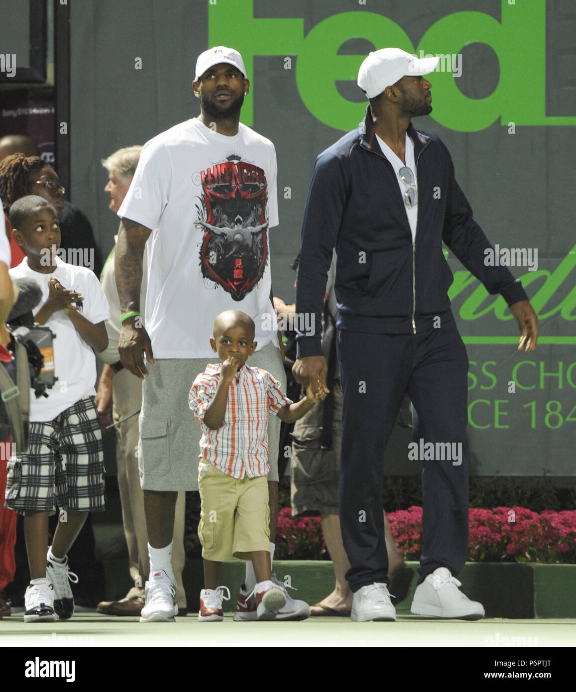 Lebron James And Dwyane Wade With Sons Stock Photos & Lebron James