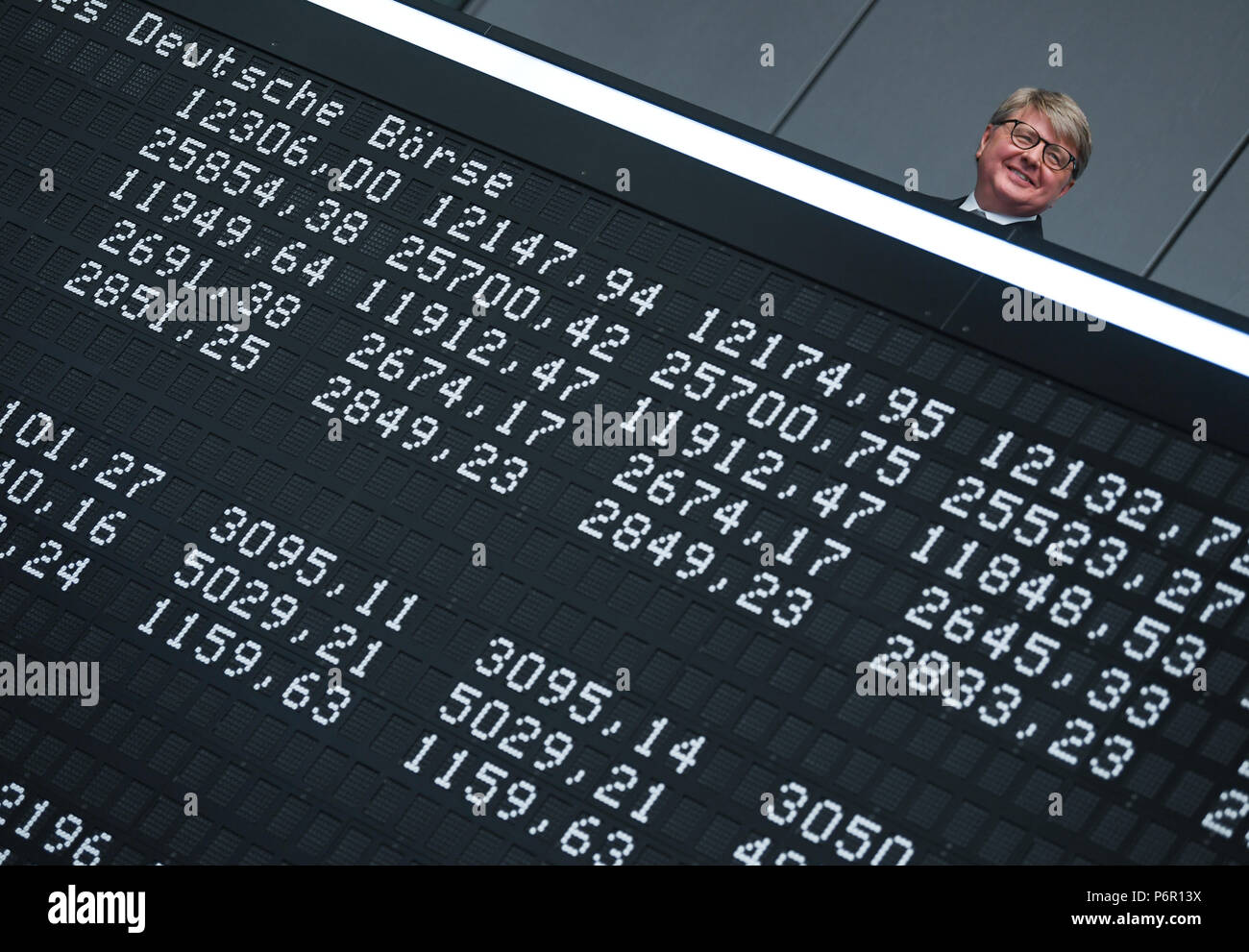 Frankfurt, Germany. 02nd July, 2018. Chairman of the Deutsche Boerse AG, Theodor Weimer (L-R), Frank Mella, standing over a display board with the indexes of the German stock exchange for the 30 year anniversary of the DAX. Thirty years after its introduction, the German lead index is one of the most significant market indicators in the world and, despite a few set backs, a success story. Since the first trading day on the 1 July 1988 with 1163 points, the German stock index has strongly increased, at times by more than 13,000 points. Credit: Arne Dedert/dpa/Alamy Live News Stock Photo