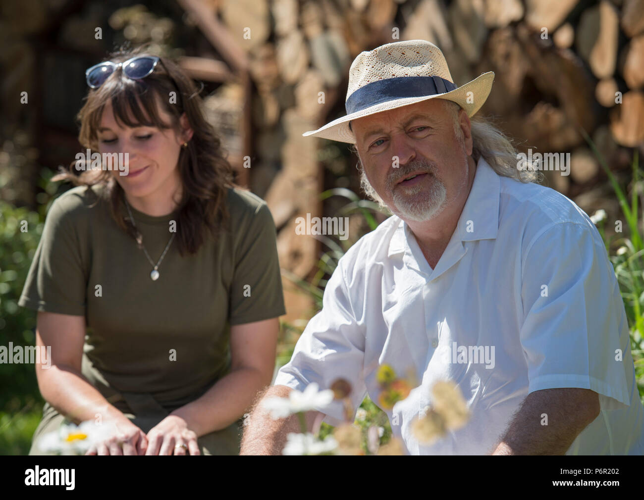 Hampton Court Palace, Surrey, UK. 2 July, 2018. The world's largest annual flower show, RHS Hampton Court Palace Flower Show supported by Viking Cruises, opens to the public from 5 - 8 July 2018. Comedian and wildlife enthusiast Bill Bailey visits The Family Garden designed by Lilly Gomm. Credit: Malcolm Park/Alamy Live News. - Stock Image