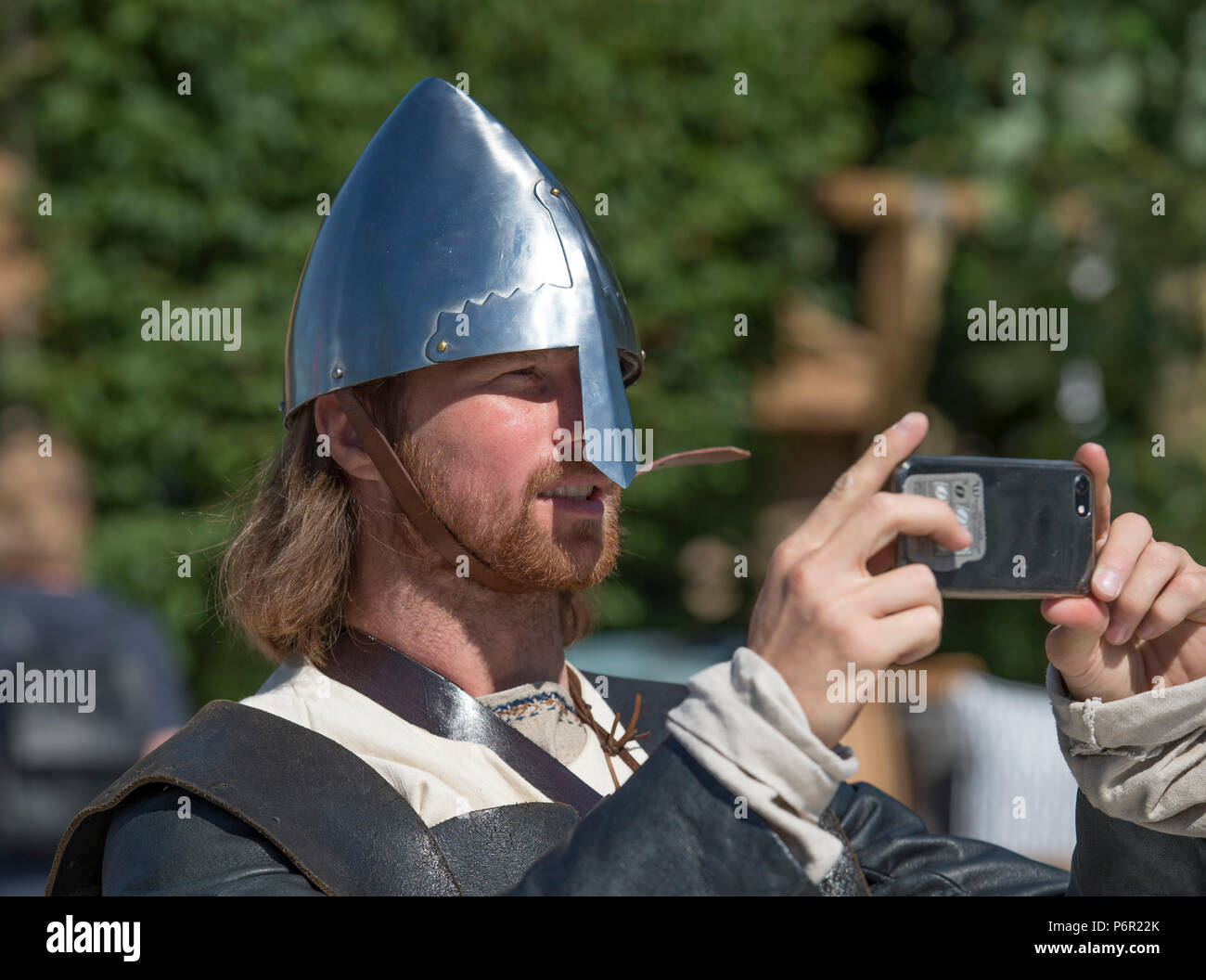 Hampton Court Palace, Surrey, UK. 2 July, 2018. The world's largest annual flower show, RHS Hampton Court Palace Flower Show supported by Viking Cruises, opens to the public from 5 - 8 July 2018. A group of authentic Vikings in traditional dress enjoy the Viking Cruises Nordic Lifestyle Garden, designed by Stephen Hall. Credit: Malcolm Park/Alamy Live News. Stock Photo