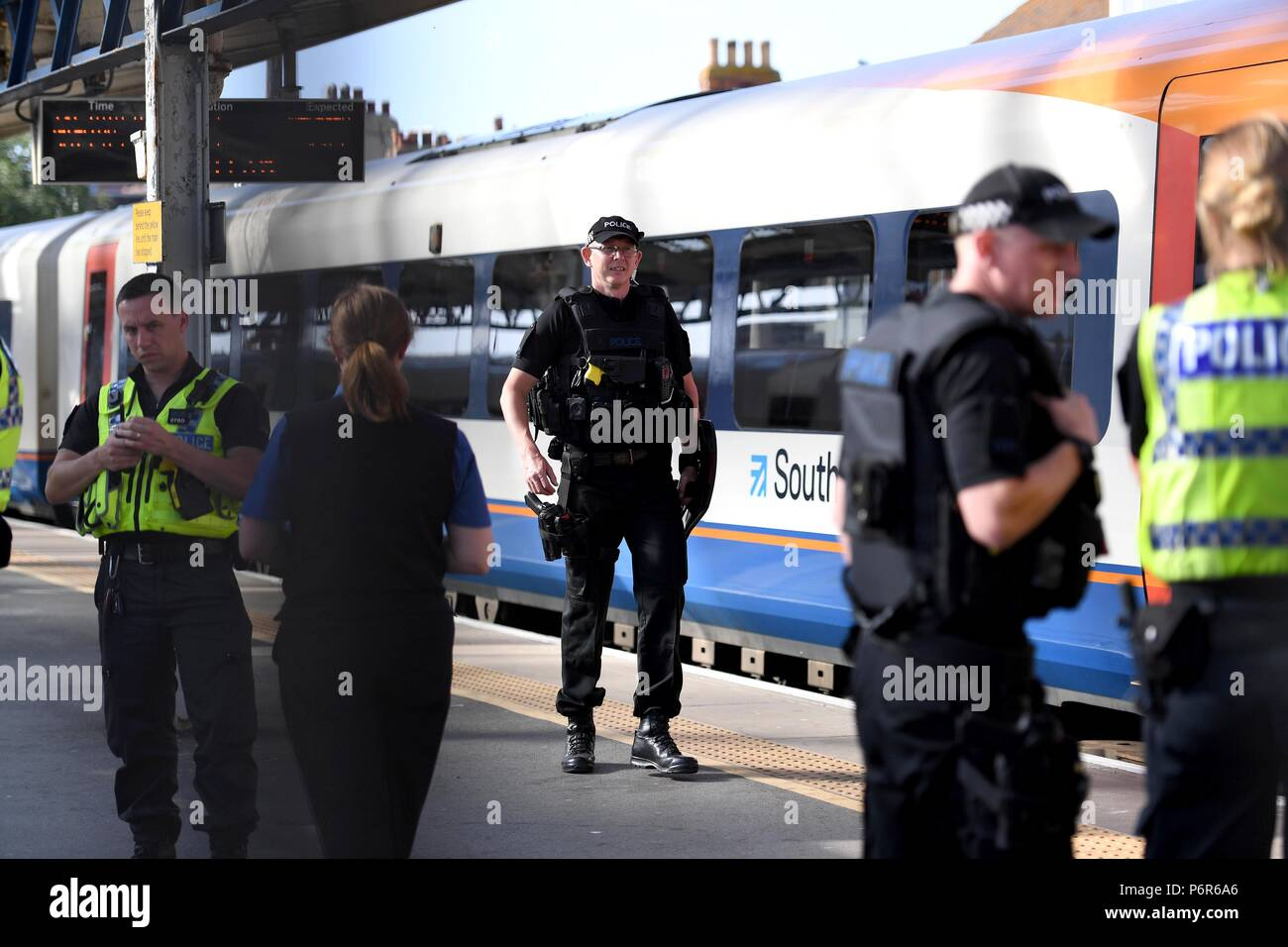 Weymouth, Dorset, UK. 2nd July 2018. A man seen 'in possession of a knife' on a train at Weymouth station. Credit: Finnbarr Webster/Alamy Live News - Stock Image