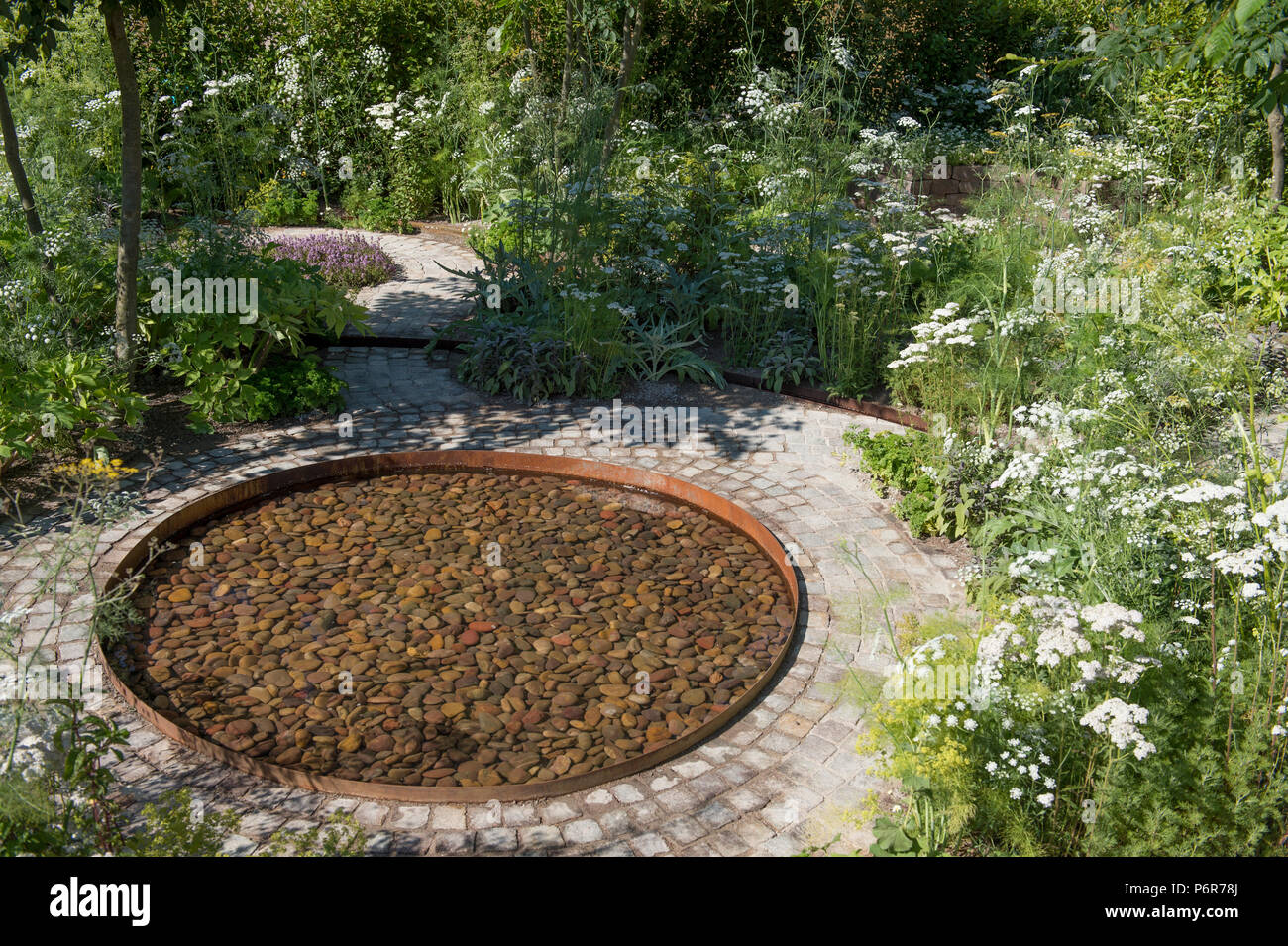 Hampton Court Palace, Surrey, UK. 2 July, 2018. The world's largest annual flower show, RHS Hampton Court Palace Flower Show supported by Viking Cruises, opens to the public from 5 - 8 July 2018. The Health and Wellbeing Garden designed by Alexandra Noble. Credit: Malcolm Park/Alamy Live News. Stock Photo