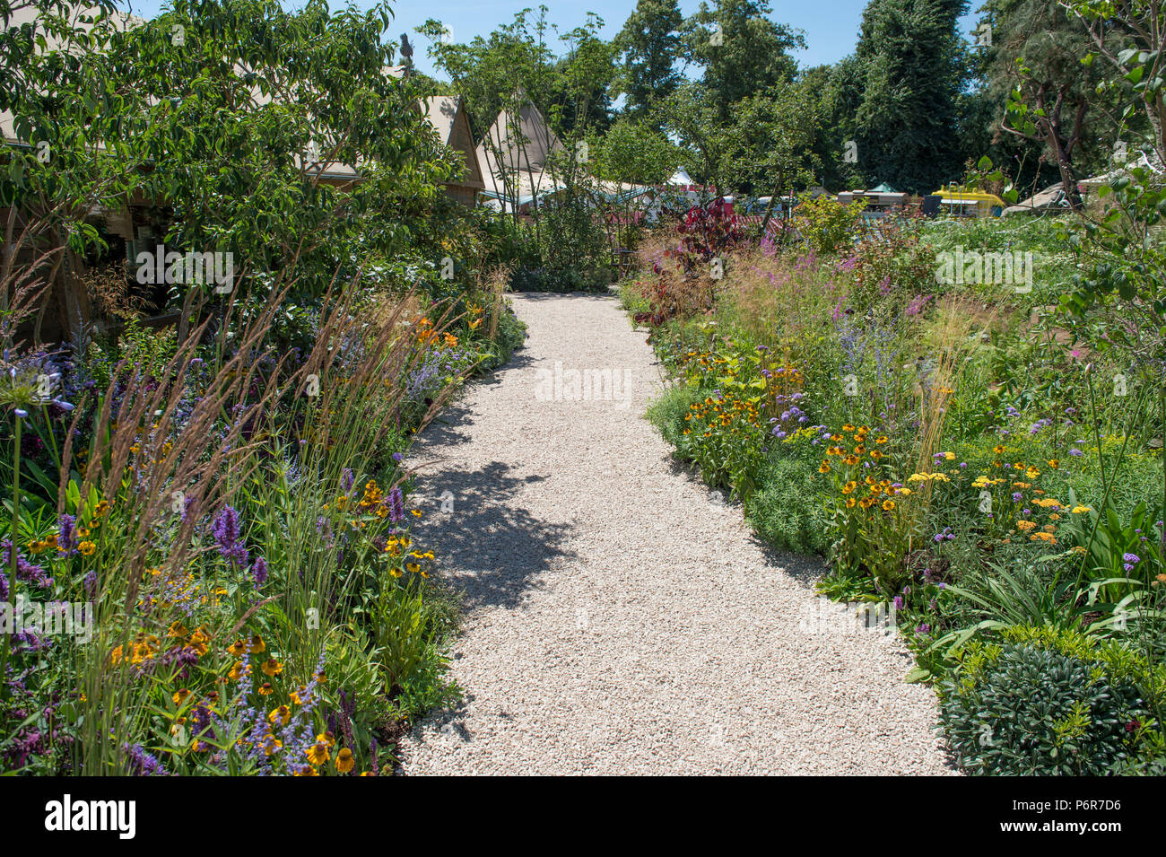 Hampton Court Palace, Surrey, UK. 2 July, 2018. The world's largest annual flower show, RHS Hampton Court Palace Flower Show supported by Viking Cruises, opens to the public from 5 - 8 July 2018. BBC Countryfile Wildlife Garden designed by Anne-Marie Powell. Credit: Malcolm Park/Alamy Live News. - Stock Image