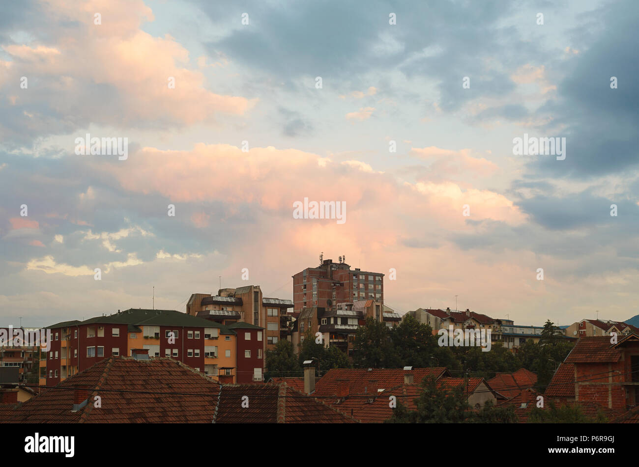Interesting and colorful sunset at one ordinary day in a small Balkan town. - Stock Image