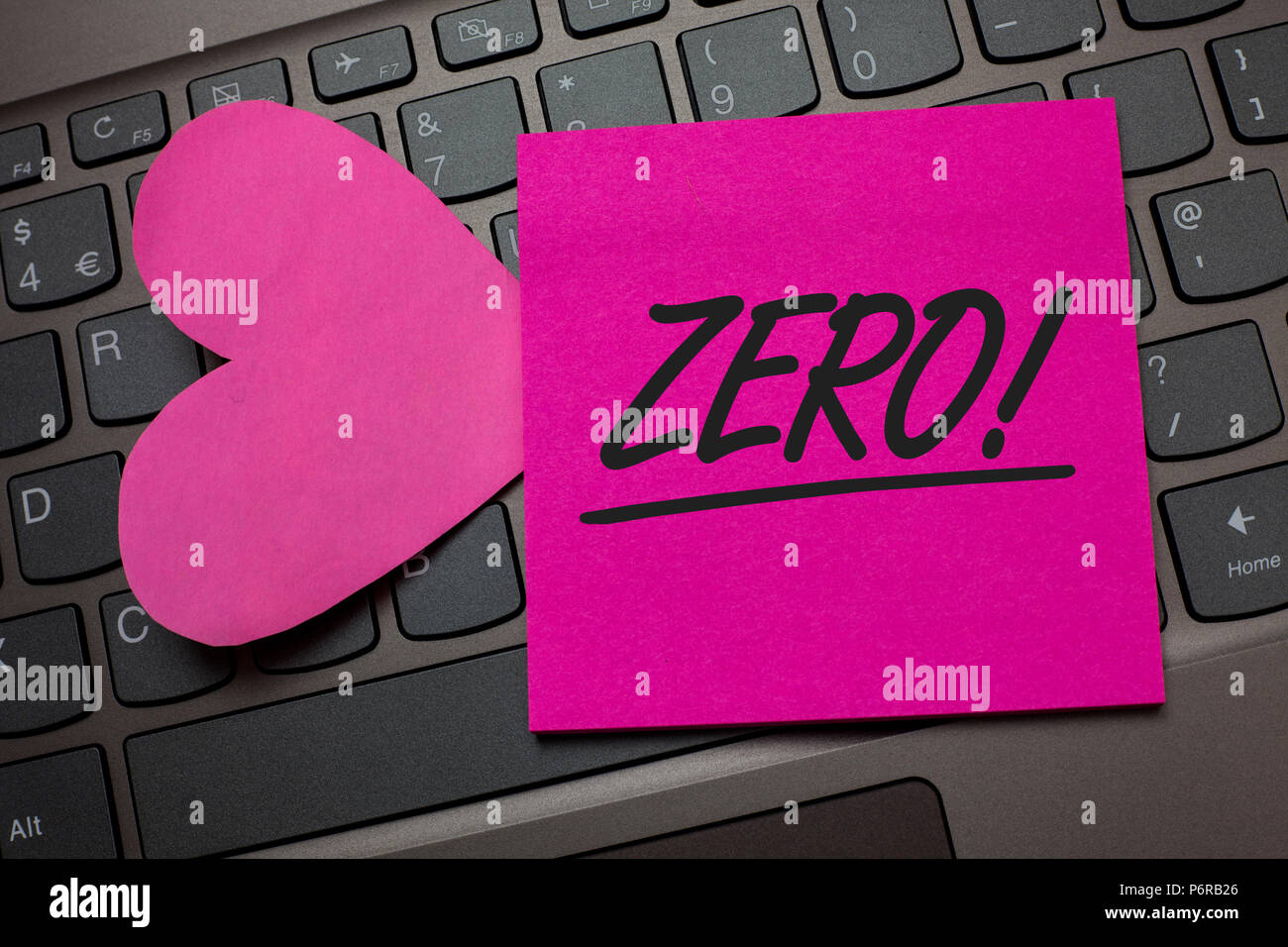 Conceptual hand writing showing Zero Motivational Call. Business photo text The emptiness nothingness of something no value Keyboard grey keys pink pa Stock Photo