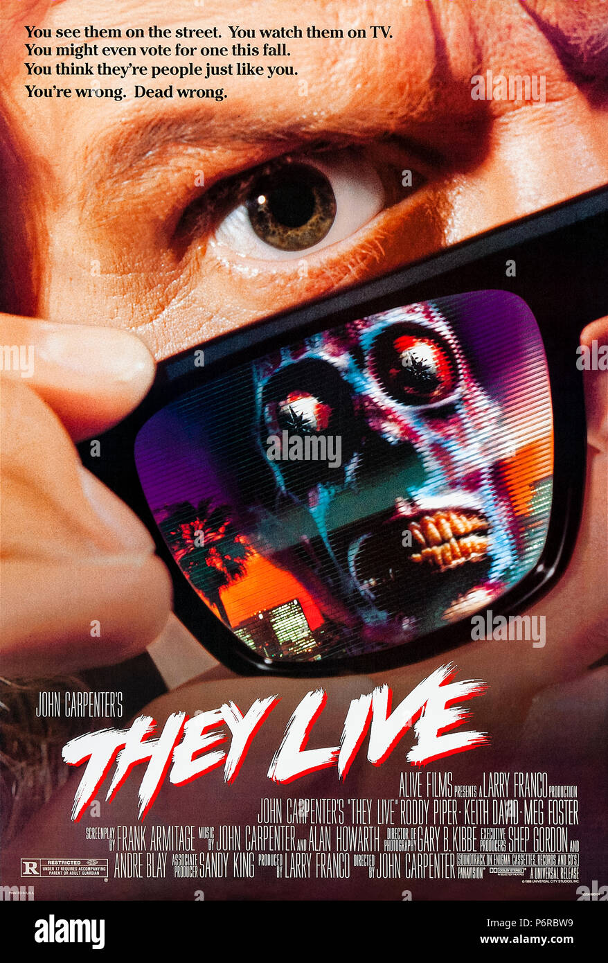 They Live (1988) directed by John Carpenter and starring Roddy Piper, Keith David and Meg Foster. An unnamed drifter finds a pair of sunglasses that reveal the truth about the world and how it manipulates and rewards its inhabitants. - Stock Image