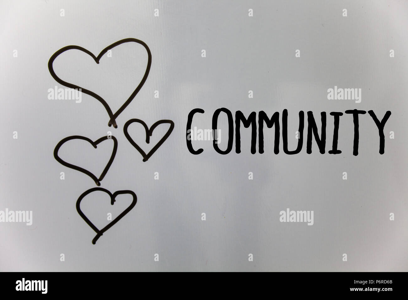 Word writing text Community. Business concept for Neighborhood Association State Affiliation Alliance Unity Group Hearts white background ideas messag - Stock Image