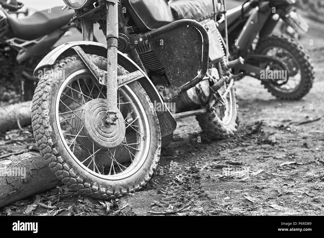 Offroad mountain motorcycle or bike taking part in motocros competition parked on dirty terrain road - Stock Image