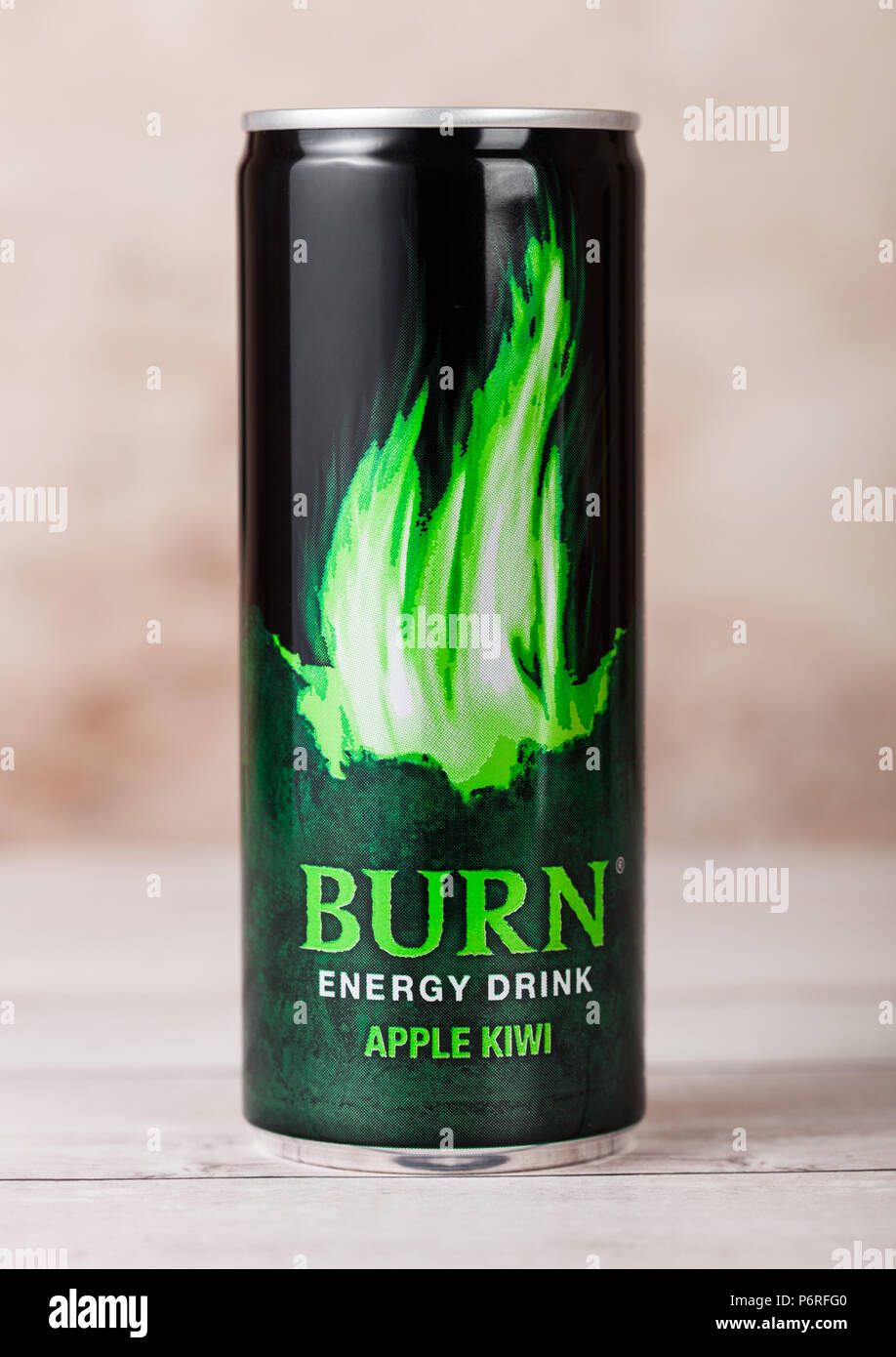 LONDON, UK - JUNE 30, 2018: Can of Burn Energy Drink Original on wooden background. Burn energy is made for keeping eyes open and mind sharp. - Stock Image