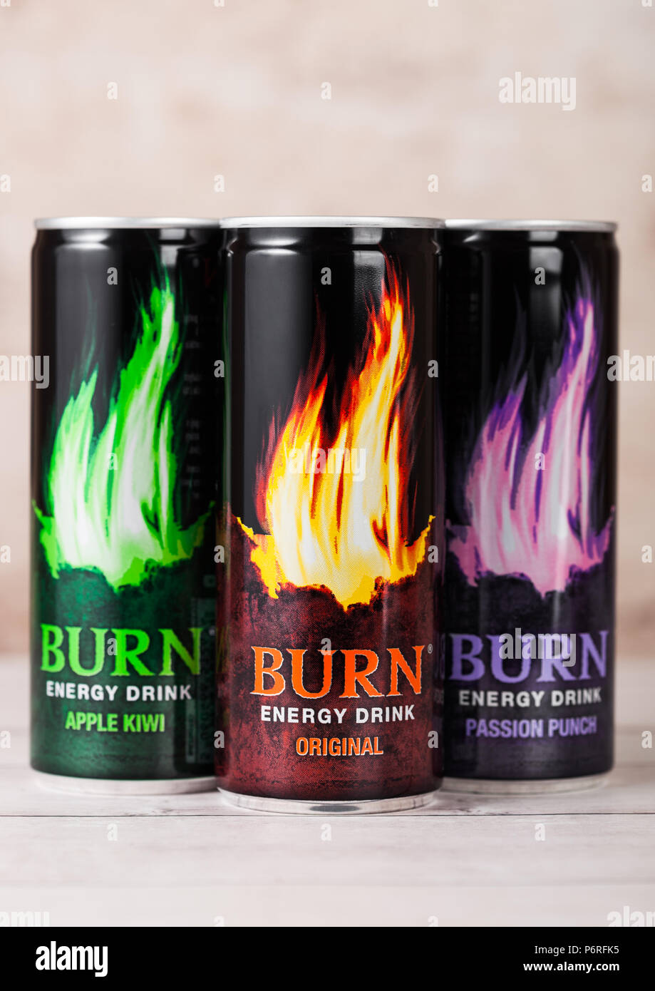 LONDON, UK - JUNE 30, 2018: aluminium tins of Burn Energy Drink Original on wooden background. Burn energy is made for keeping eyes open and mind shar - Stock Image