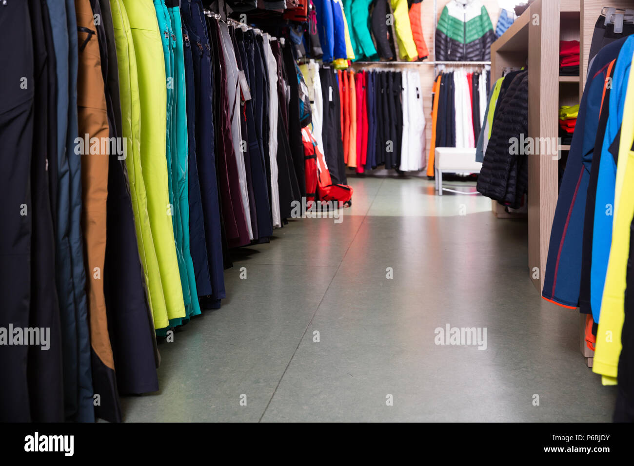Store interior with large choice of modern skiwear - Stock Image