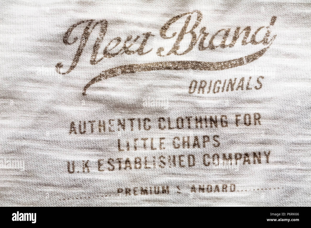Next Brand Originals authentic clothing for little chaps UK Established Company premium standard - detail printed in clothing Stock Photo