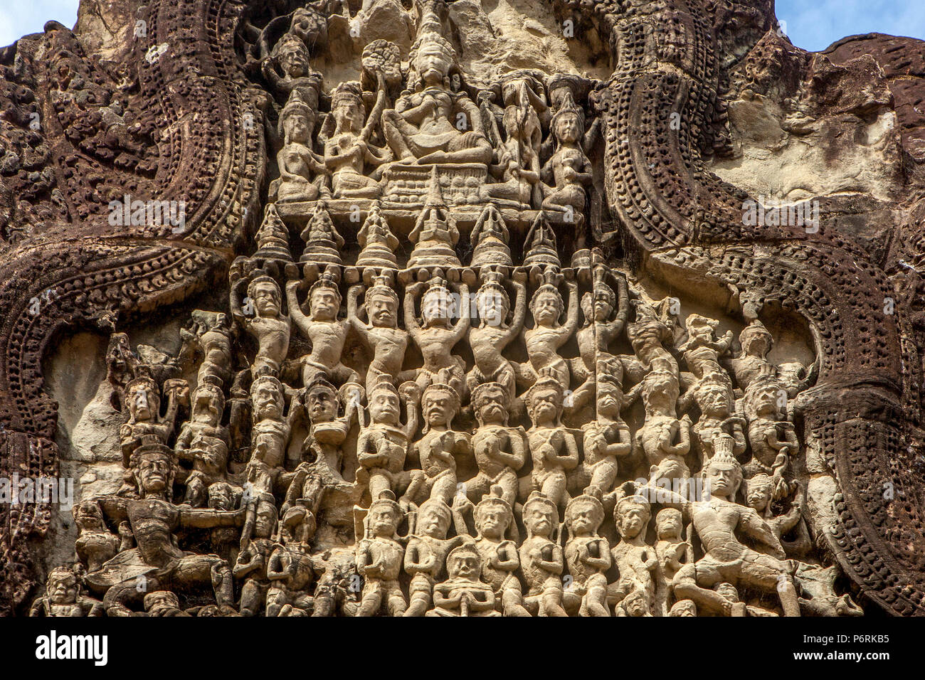 Ornately carved sandstone pediment at Angkor Wat temple at Siem Reap, Cambodia. - Stock Image