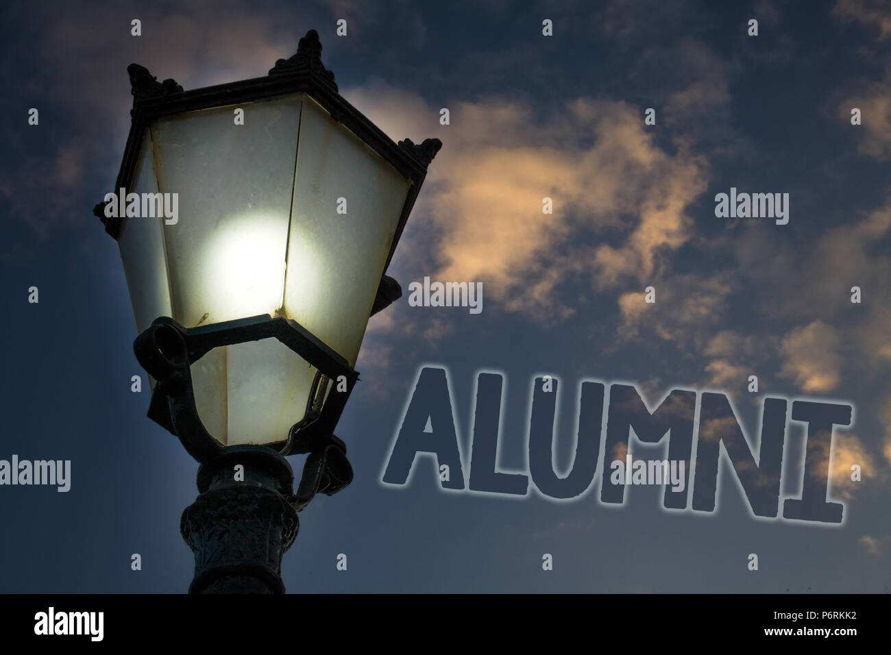 Conceptual hand writing showing Alumni. Business photo showcasing Alum Old graduate Postgraduate Gathering College Academy Celebration Light post blue - Stock Image