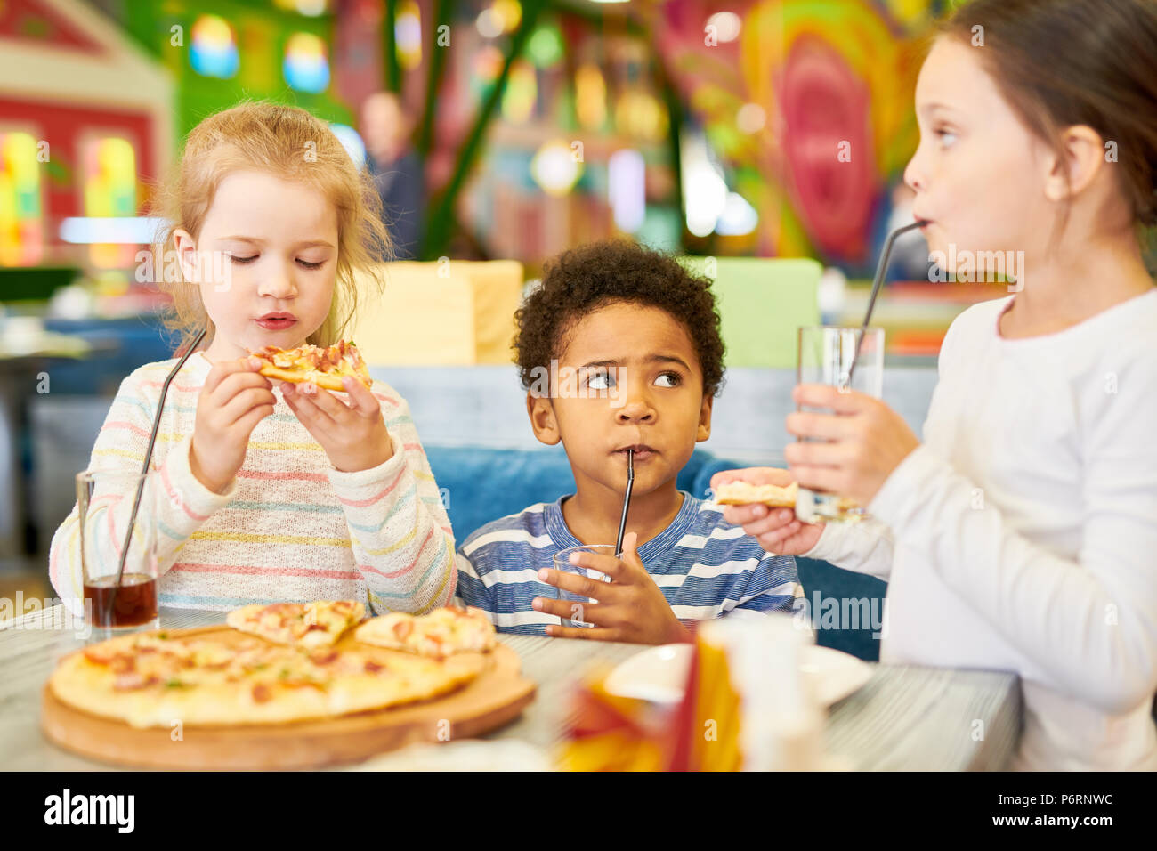 Cute Kids in Cafe - Stock Image