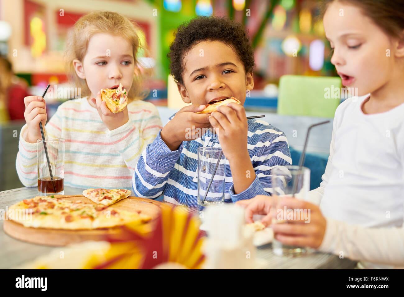 Children in Pizzeria Cafe - Stock Image