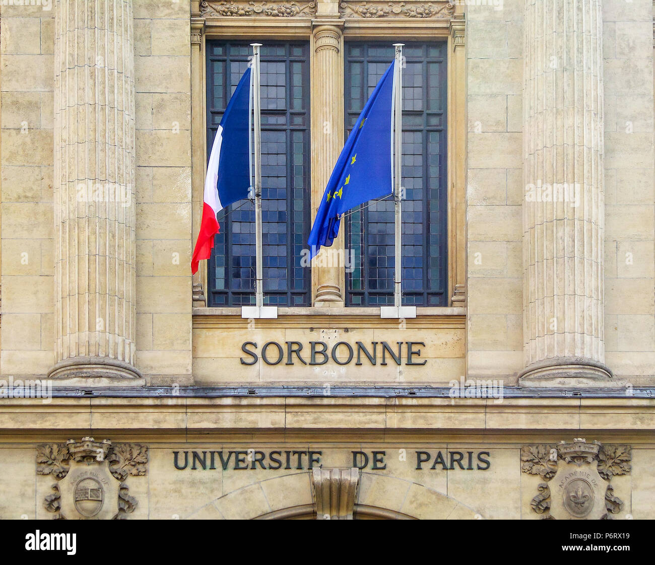 Sorbonne, universite de Paris (meaning university of Paris), written on a wall with the French and European flags - Stock Image