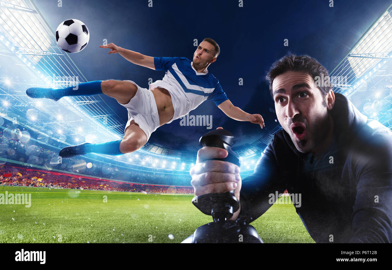 Boy with joystick plays with soccer video game - Stock Image