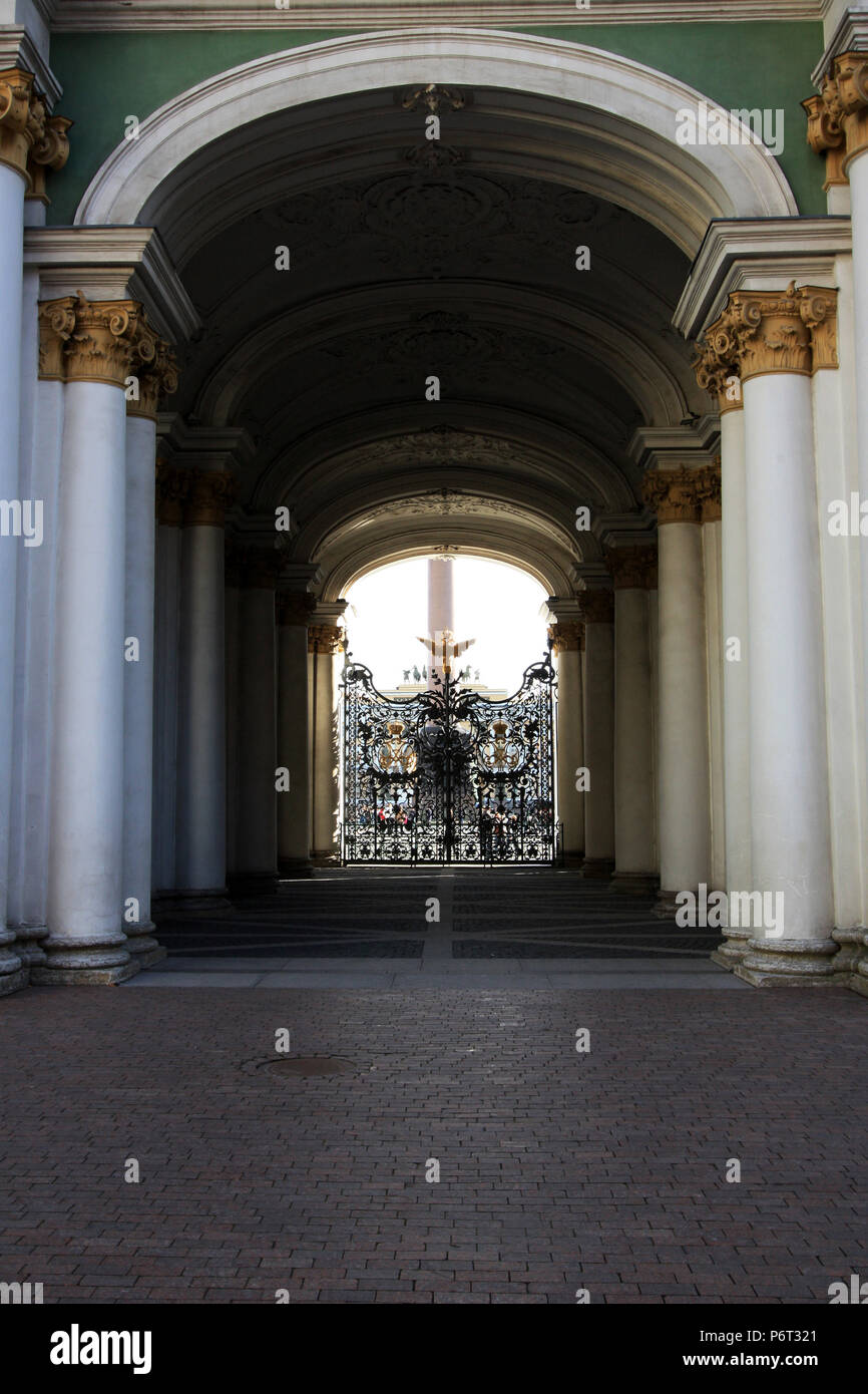 Double-headed eagle guarding the patterned wrought-iron gate of the Hermitage in St. Petersburg, Russia - seen from inside the courtyard - Stock Image