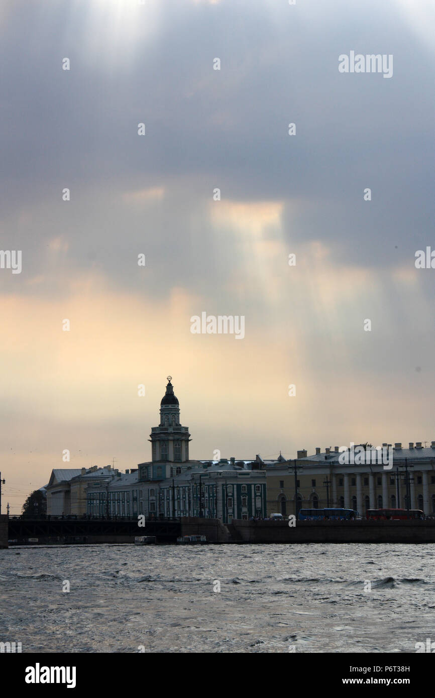 Dramatic sky over the silhouette of the Kunstkamera, also known as Kunstkammer, in St. Petersburg, Russia - Stock Image