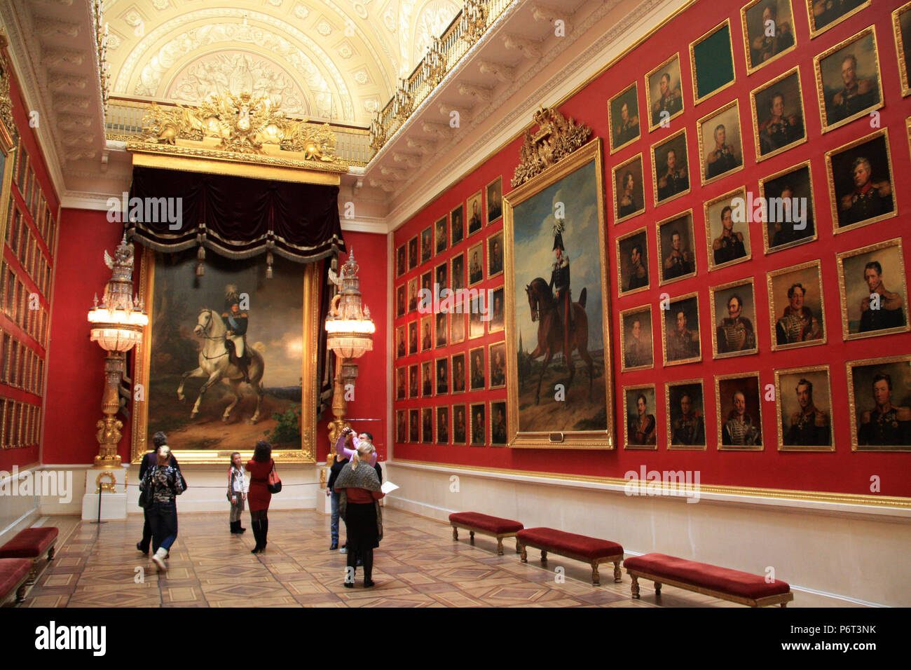 People looking at artworks inside the Hall of Fame Portrait Gallery of the 1812 Patriotic War at the State Hermitage Museum in St. Petersburg, Russia Stock Photo