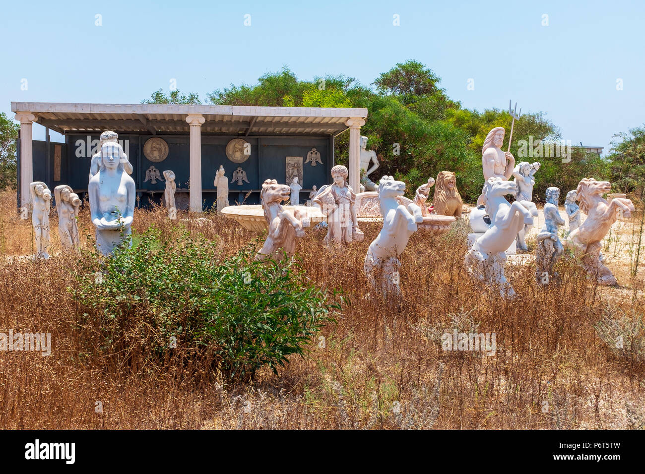 A number of Greek styled garden statues standing in a disused garden ...