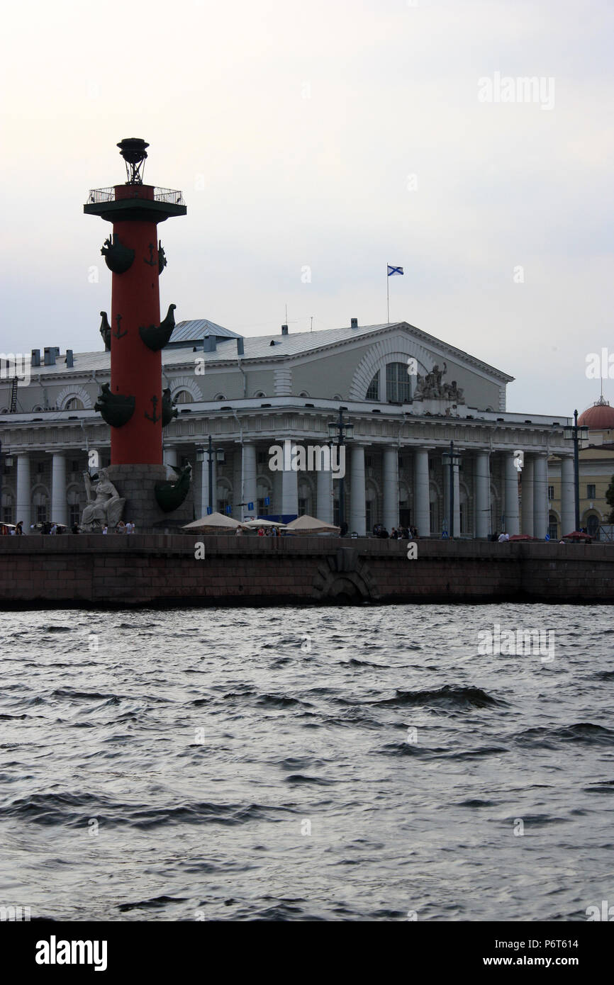 Exterior view of the Naval Museum, the Old Stock Exchange and the Rostral Column on Vasilyevsky Island in St. Petersburg, Russia Stock Photo
