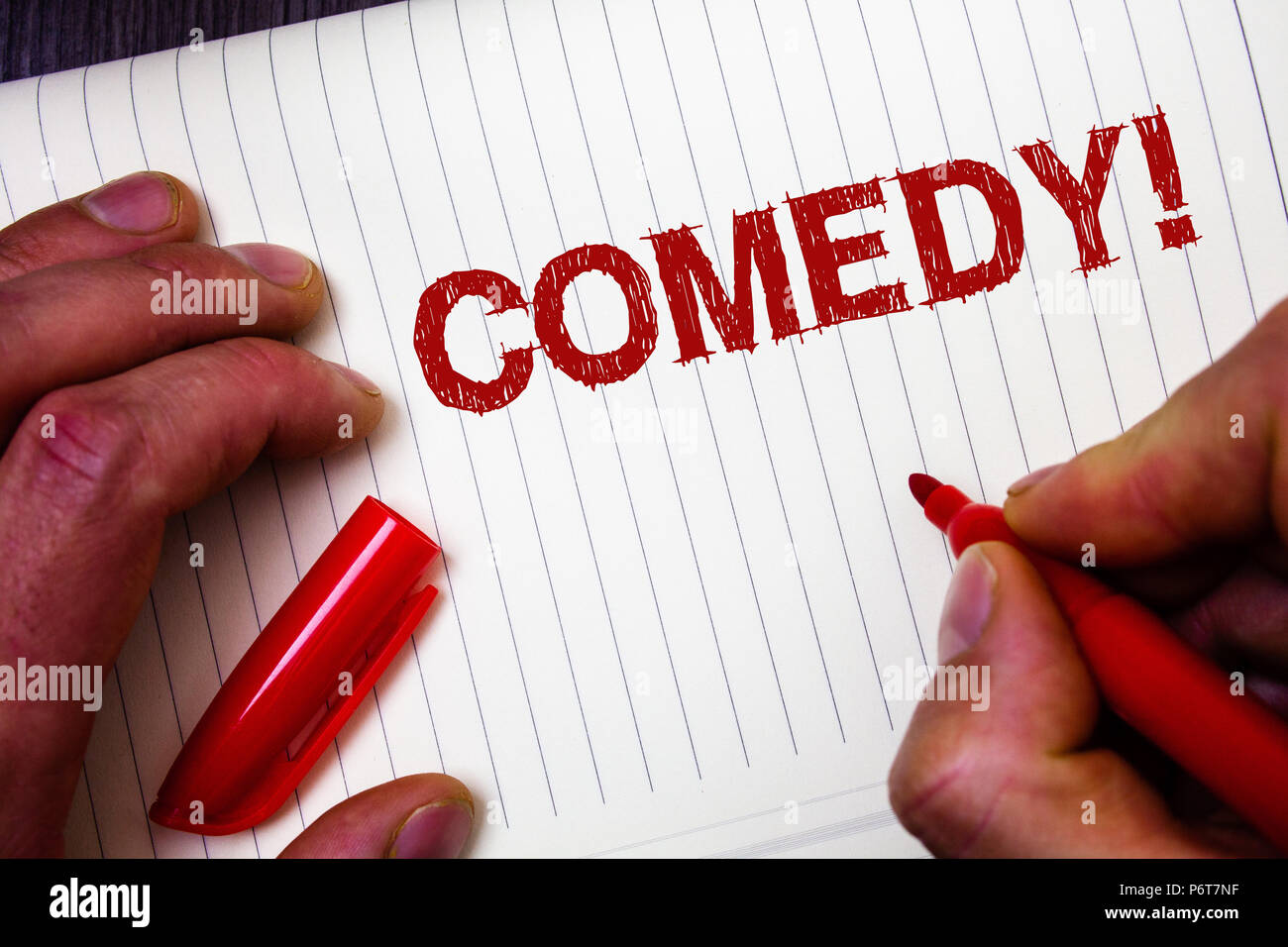 Conceptual hand writing showing Comedy Call. Business photo showcasing Fun Humor Satire Sitcom Hilarity Joking Entertainment Laughing Man hold holding - Stock Image