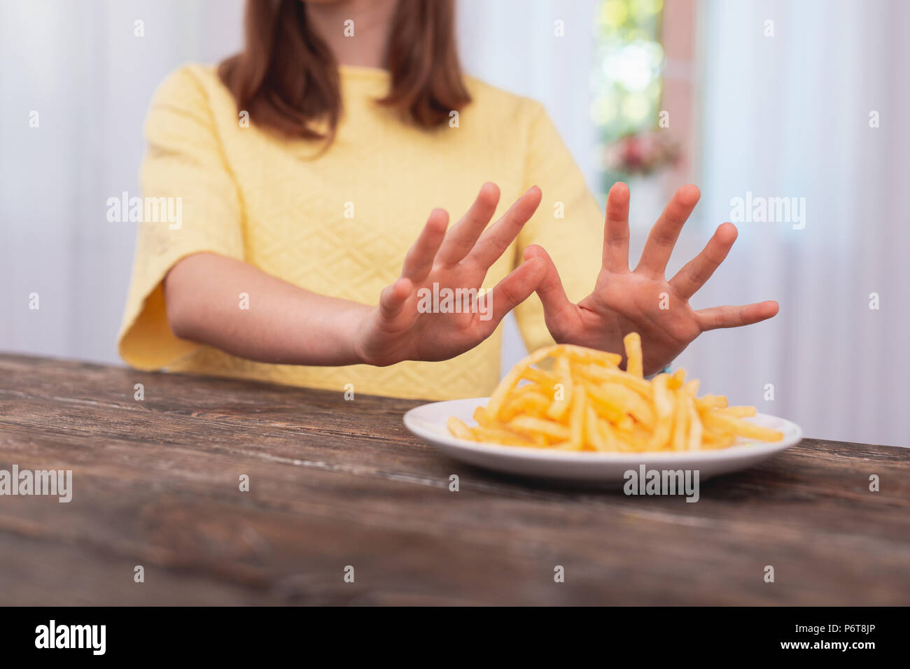 Smooth female hands moving plate - Stock Image