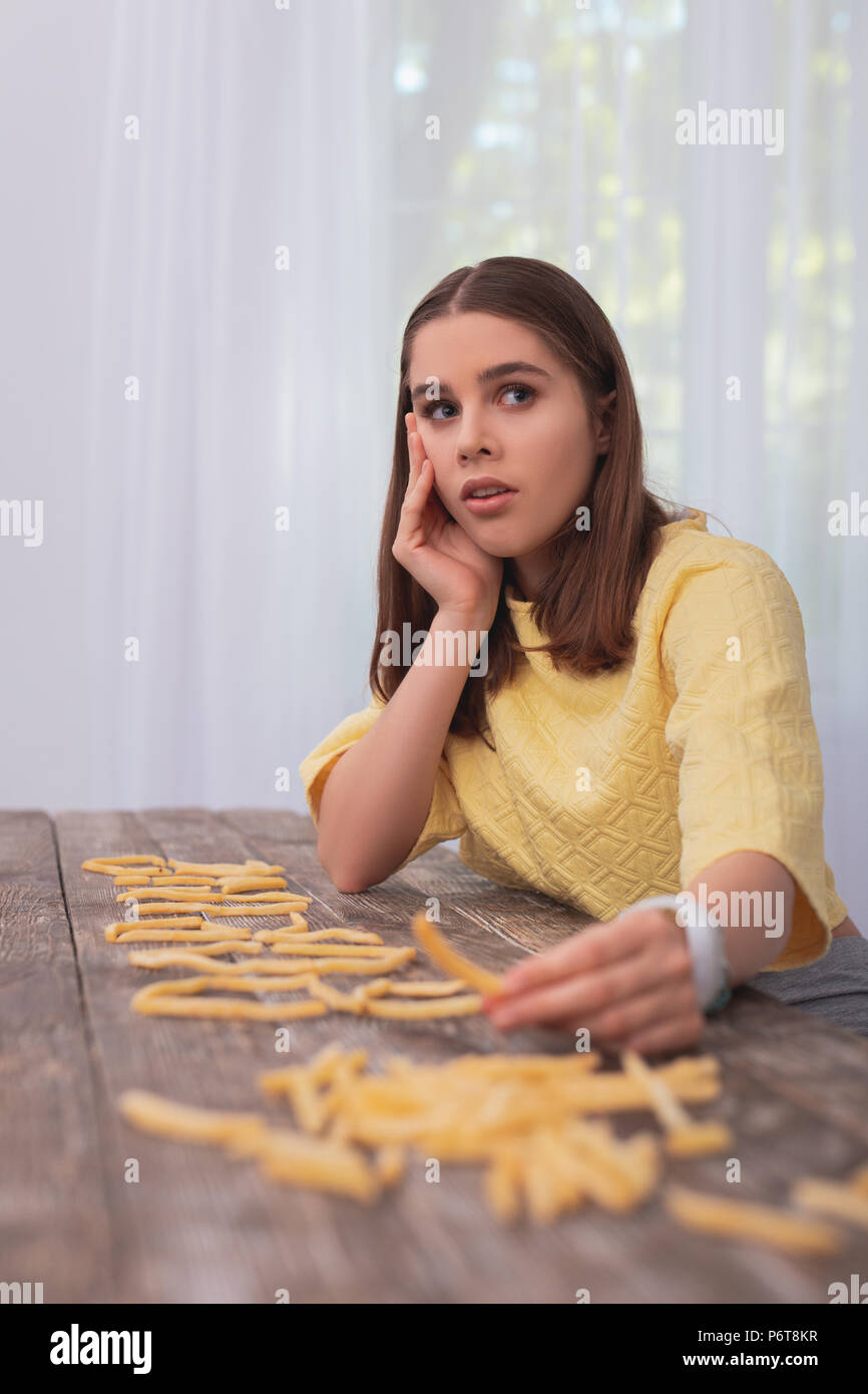 Astonished teen girl refusing from junk food - Stock Image