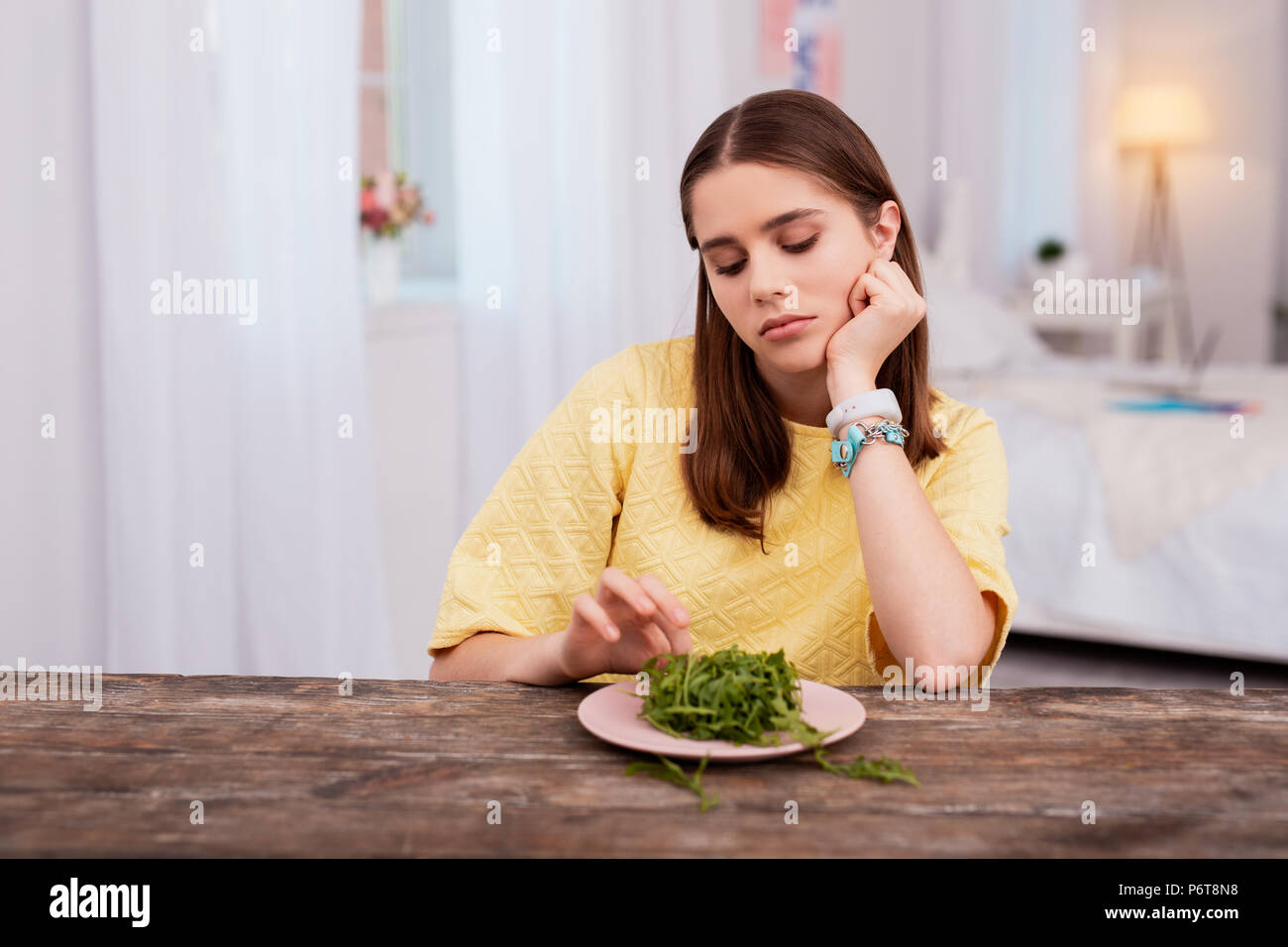 Charming teen girl loosing weight - Stock Image