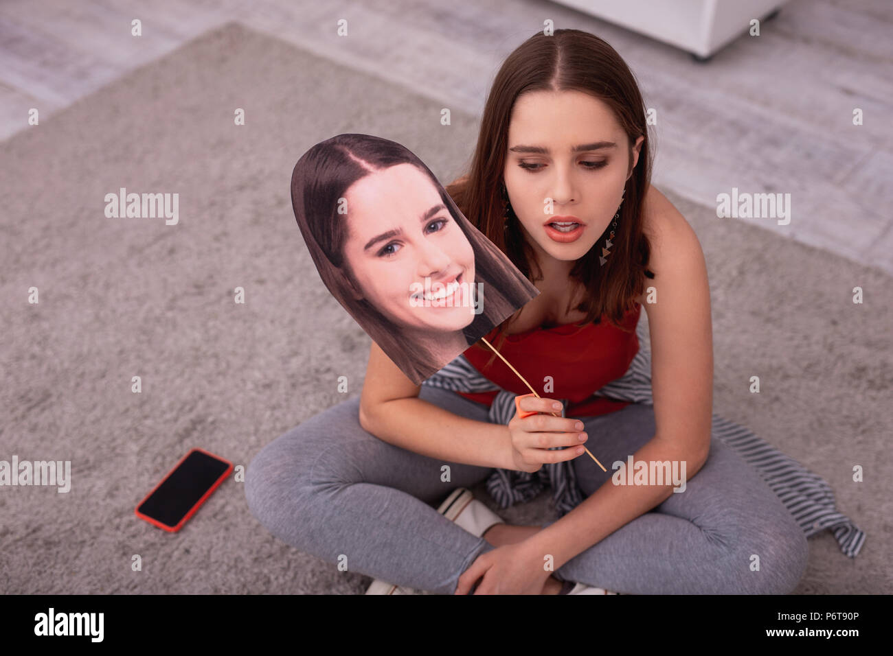 Hopeless teen girl suffering from depression - Stock Image