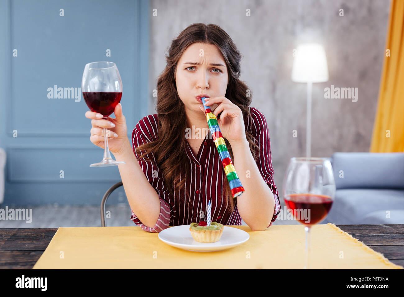 Blue-eyed girl feeling melancholic on her birthday - Stock Image