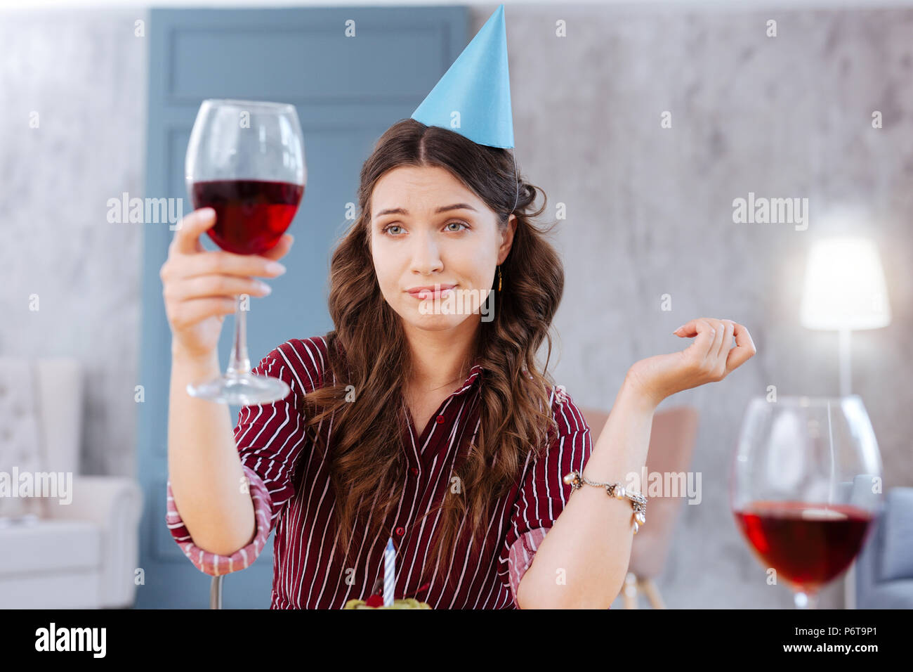 Young businesswoman attending birthday party of her niece - Stock Image