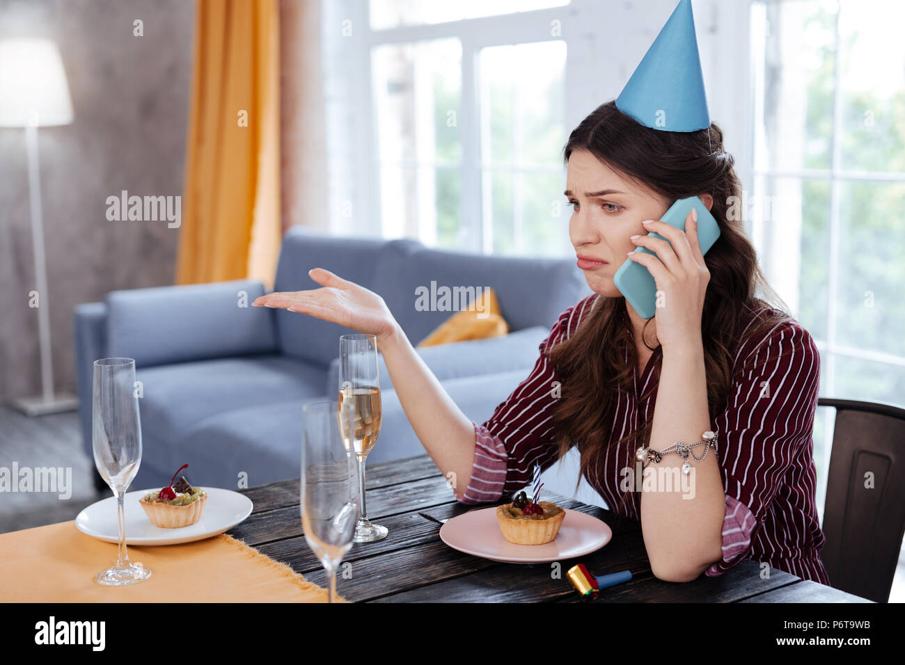 Birthday woman feeling angry hearing stupid excuses - Stock Image